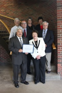 Karen Springmeier (front right), Executive Director of FLWIB, presents Bob Pagano(front left), President of ITT-Goulds, with the Business of the Month certificate. Joining them (from left to right) are; John Vrabel, Deputy Director of Finger Lakes Works- Seneca County, Bob Aronson, Executive Director of Seneca County IDA, Peg Birmingham, Deputy Commissioner of Finger Lakes Works- Seneca County, Margaret Gan, Director of Communications at ITT-Goulds, and Ron Golumbeck, VP & Director of Human Resources at ITT- Goulds.