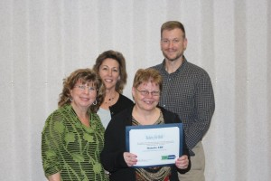 From left: Ann Scheetz, Executive Director; Lora Winghart, Associate Executive Director, Program Services; Cindy Buck, Ontario ARC volunteer for FLWIB; Josh Elias, Director, Employment Services.