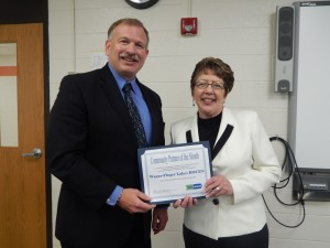 Scott Bischoping, Superintendent of WFL-BOCES receives the award for Community Partner of the Month from Karen Springmeier, Executive Director of FLWIB, Inc.