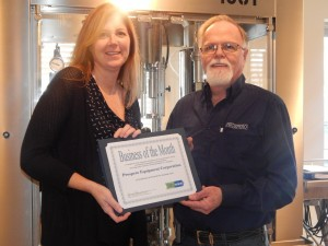 Kathy Bailey, Business Service Representative of Finger Lakes Works-Ontario County, presents the award to Richard Turner, Operations Manager for Prospero Equipment.