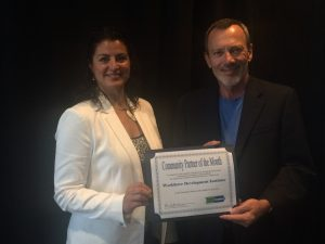 Lynn Freid and Bob Trouskie receiving the award on behalf of the Workforce Development Institute.